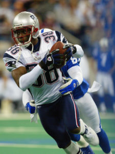 INDIANAPOLIS, IN - NOVEMBER 30:  Cornerback Tyrone Poole #38 of the New England Patriots carries the ball against the Indianapolis Colts during the game at the RCA Dome on November 30, 2003 in Indianapolis, Indiana. The Patriots defeated the Colts 38-34. (Photo by Andy Lyons/Getty Images)